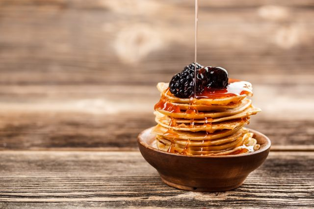 honey honey-pouring-over-a-stack-of-mini-pancakes