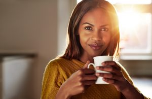 young-black-woman-drinking-a-cup-of-fresh-coffee