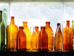 bottles Brown and green old glass bottles on windowsill
