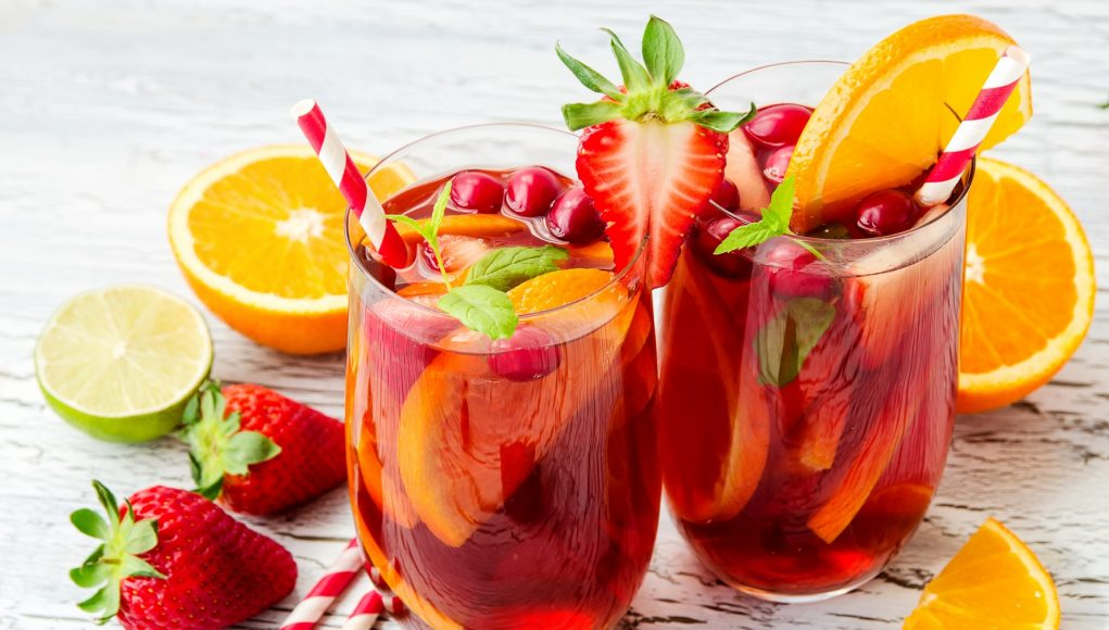 punch Cranberry drink, homemade lemonade or sangria with citrus fruits and berries