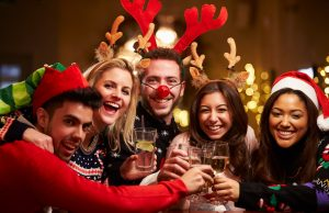 party Group Of Friends Enjoying Christmas Drinks In Bar