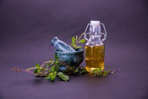 tulsi-oil-or-holy-basil-oil-with-mortar-and-pestle