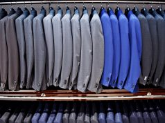 Elegant blue and gray suits on hangers