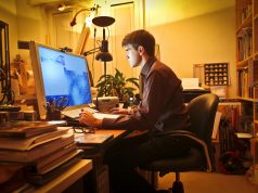 Young man at home using a computer working