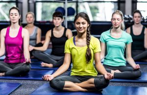 a group doing yoga in gym insomnia cure
