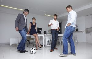 work jeans Business team playing football