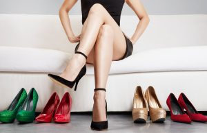 woman sitting on the sofa with stilettos