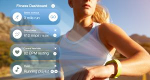 exercising-woman-checking-notifications-on-health fitness wearables