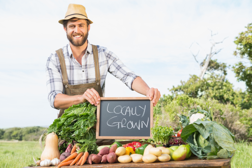 farmer-selling-his-organic-produce-on