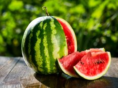 fresh-sliced-watermelon-wooden-backgroundripe-striped fruit