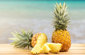 pineapple-on-wooden-table-tropical-landscape pineapples