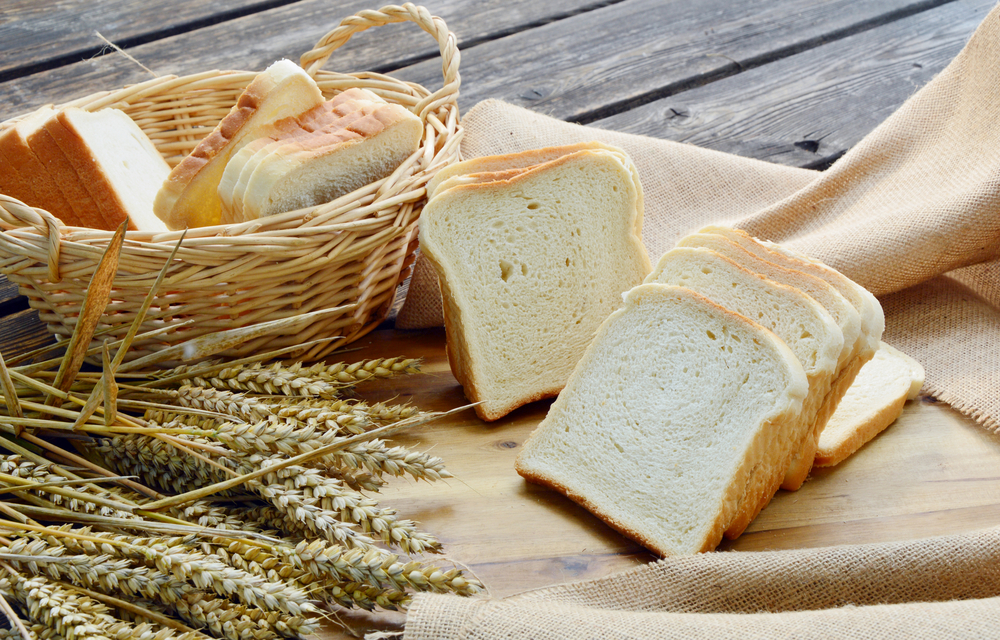 white-bread-sliced-basket-on-wooden-448631695