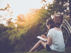beautiful-woman-writing-into-her-diary journaling
