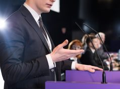 closeup-young-formallydressed-man-giving-public public speaking