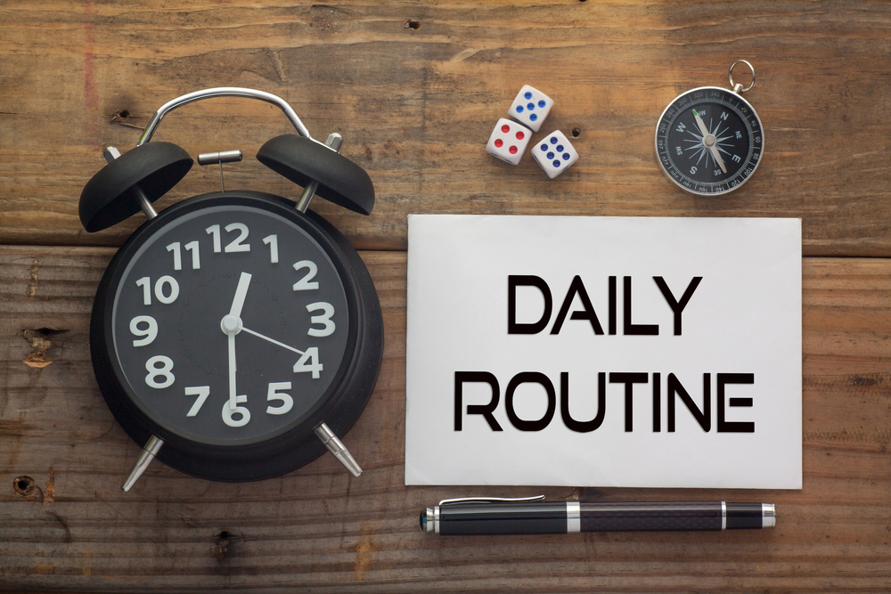 daily-routine-written-on-paper-wooden