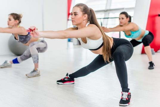fit-young-girls-doing-side-lunges