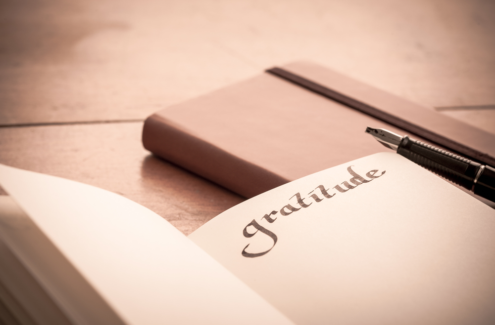 notebook-on-wooden-table-gratitude-journal