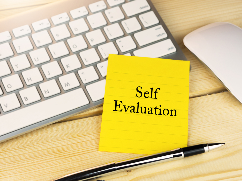 self-evaluation-on-sticky-note-work