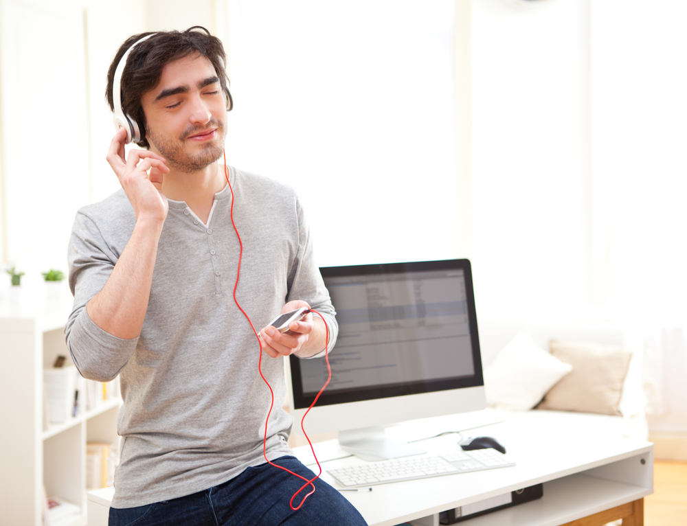 view-young-relaxed-man-listenning-music