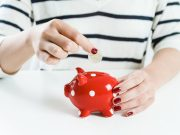 woman-saving-money-red-piggy-bank save